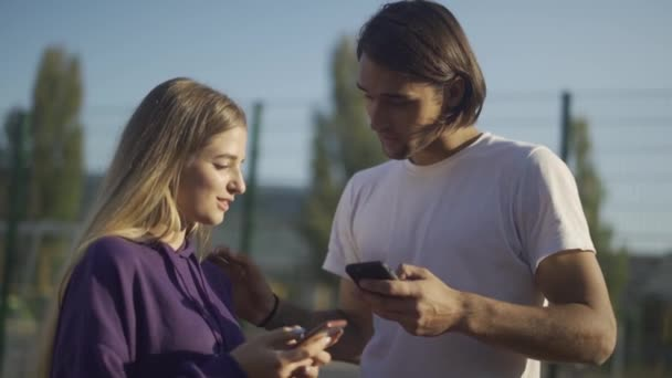 Young people exchange their phones