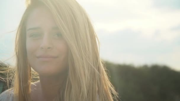 Portrait cute young beautiful woman with amazing blond hair in the wind