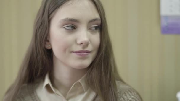 Portarait of young beautiful girl with long hair