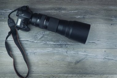 camera on a wooden background