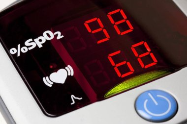 Closeup of display of pulse oximeter to measure pulse rate and blood oxygen saturation