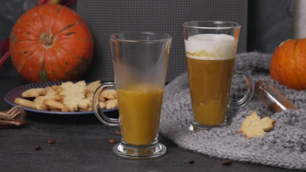 Pouring pumpkin sweet spicy latte with autumn cookies