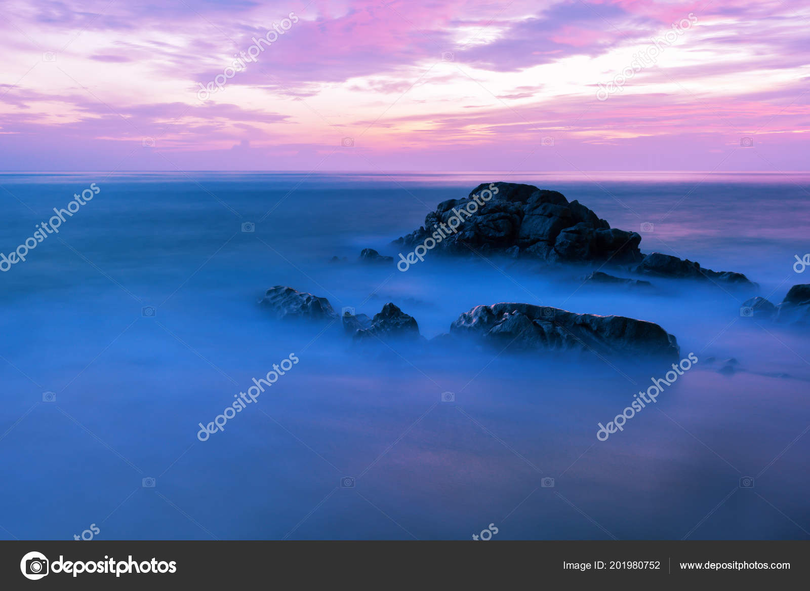 Long Exposure Image Of Dramatic Sky And Wave Seascape With Rock In Sunset Scenery Backgroundbeautiful Landscape For Nature Background Or Wallpaper Photo