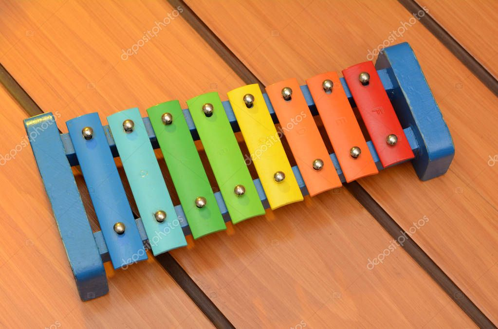 Glockenspiel xylophone colorful design on wooden background
