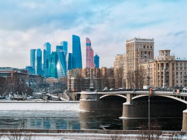 Beautiful landscape of Moscow architecture with Borodinsky bridge, old classical buildings and modern city skyscrapers. Explore Moscow city downtown landmarks, copy space