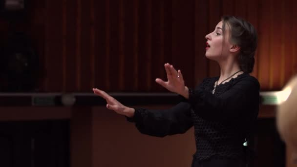 choir conductor during performance