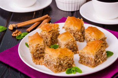 Homemade baklava with filo dough and walnuts in honey and sugar syrup