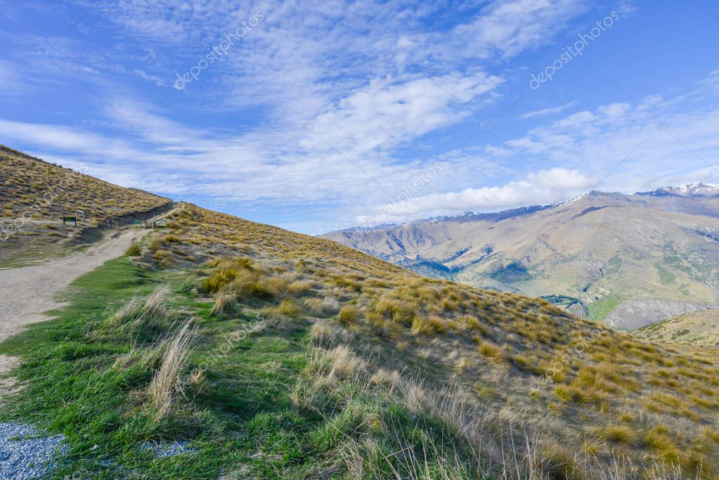 Valley is covered with brown grass in New Zealand