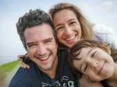 caucasian family portrait selfie only son thirty year old parents only son child