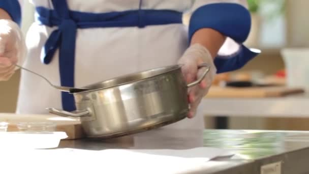 The process of cooking salad. Morning at the restaurant. Cook in uniform
