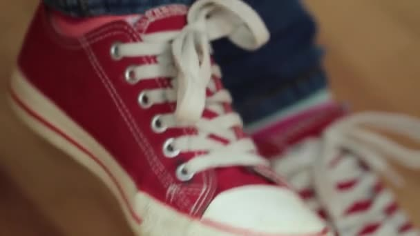 Fashionable red sneakers. Shake your foot in time with the music
