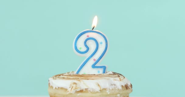 Number 2 Candle In Cake On Pastel Blue Background Stock Footage