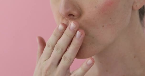 Woman sends an air kiss with her hand and lips