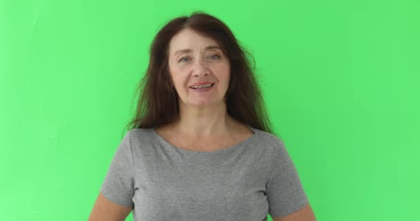 Portrait of mature woman in her 50s smiling at camera
