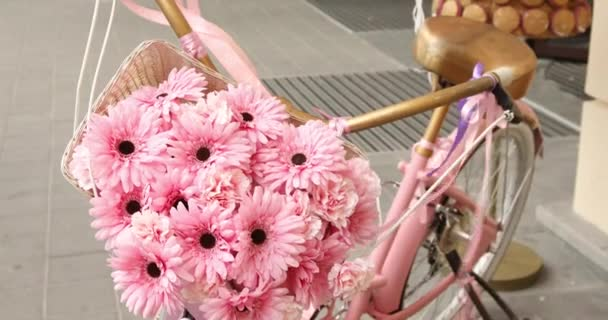 Vintage pink bicycle with flower basket