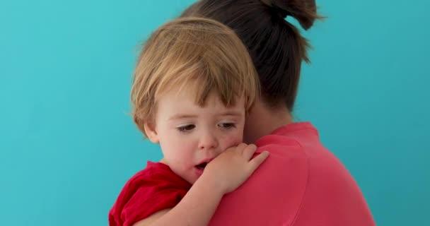 Mother hugging adorable little child