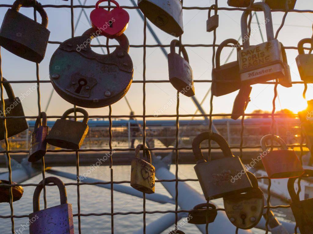 Plenty of padlocks on the bridge in Cracow during sunset