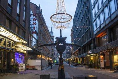HELSINKI, FINLAND - January 3, 2018: Fazer's rooster (Fazerin kukko) - modern sculpture in the historical center of Helsinki