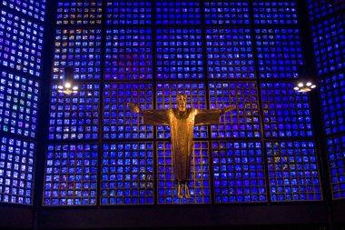 BERLIN, GERMANY - September 25, 2018: Interior of Kaiser Wilhelm Memorial Church (modern building) on the Breitenbachplatz. Crucified Jesus Christ, by architect Karl Hemmeter