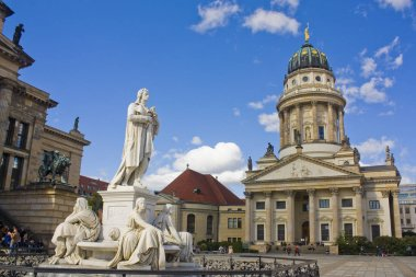 BERLIN, GERMANY - September 25, 2018: Schiller Monument in front of Concert Hall (Konzerthaus) on Gendarmenmarkt Square in Berlin