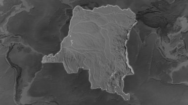 Democratic Republic of the Congo area enlarged and glowed on a darkened background of its surroundings. Grayscale bumped elevation map
