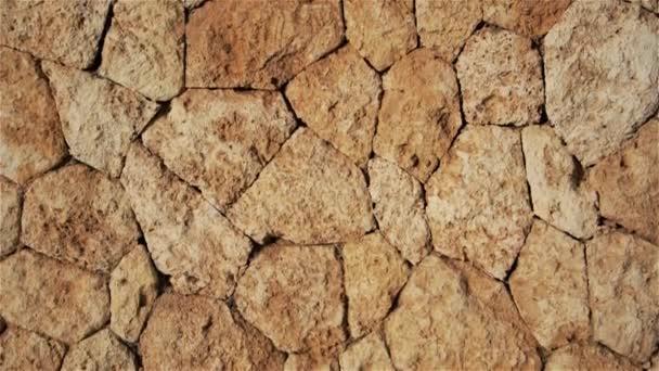 Természetes barna háttér kövek és sziklák (macskakövek)