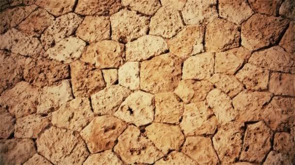 Přírodní hnědé pozadí kamenů a dlažebních kostek