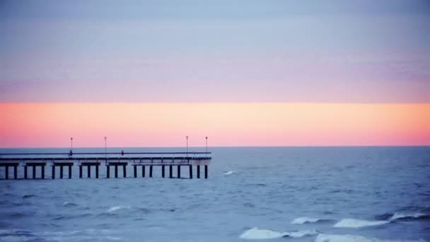 Picturesque sunset over the sea. The bridge in Palanga, Lithuania.
