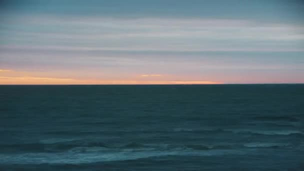 Picturesque sunset over the sea. The sky changes color. TimeLapse