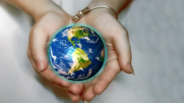 Beautiful planet Earth in female hands. Elements of this image provided by NASA