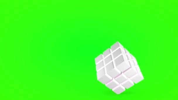 Otočení kostky pod úhlem, izolované na zeleném pozadí. 3D vykreslování