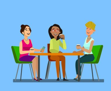 Three girls sitting at a table together talking to coffee break.
