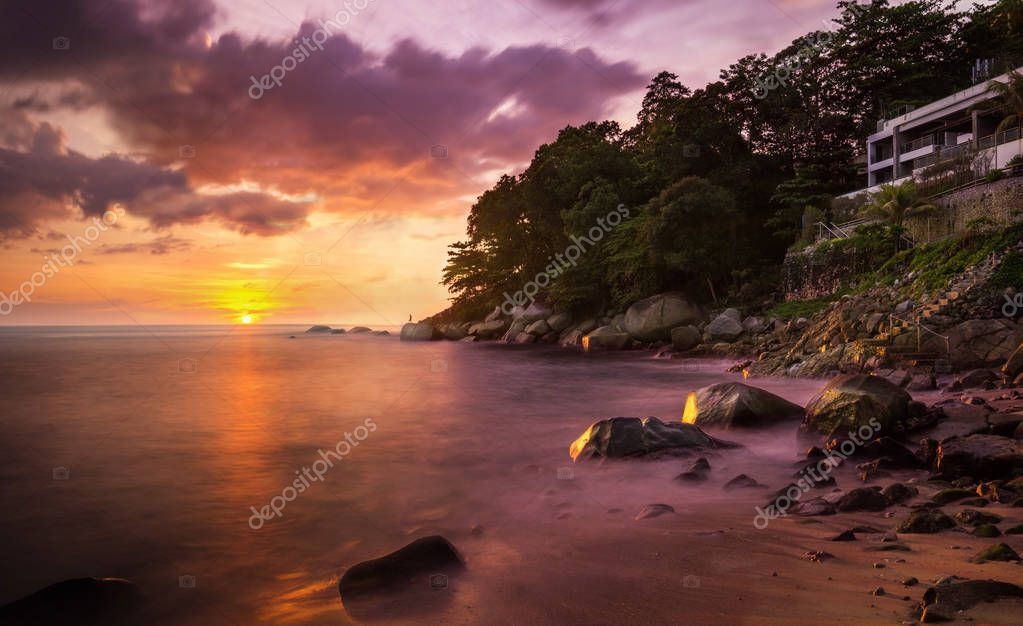 Iguana Beach in Patong, Phuket, Thailand. Capture the sunset shoot with long exposure, make the strong wave have a harmonic view.