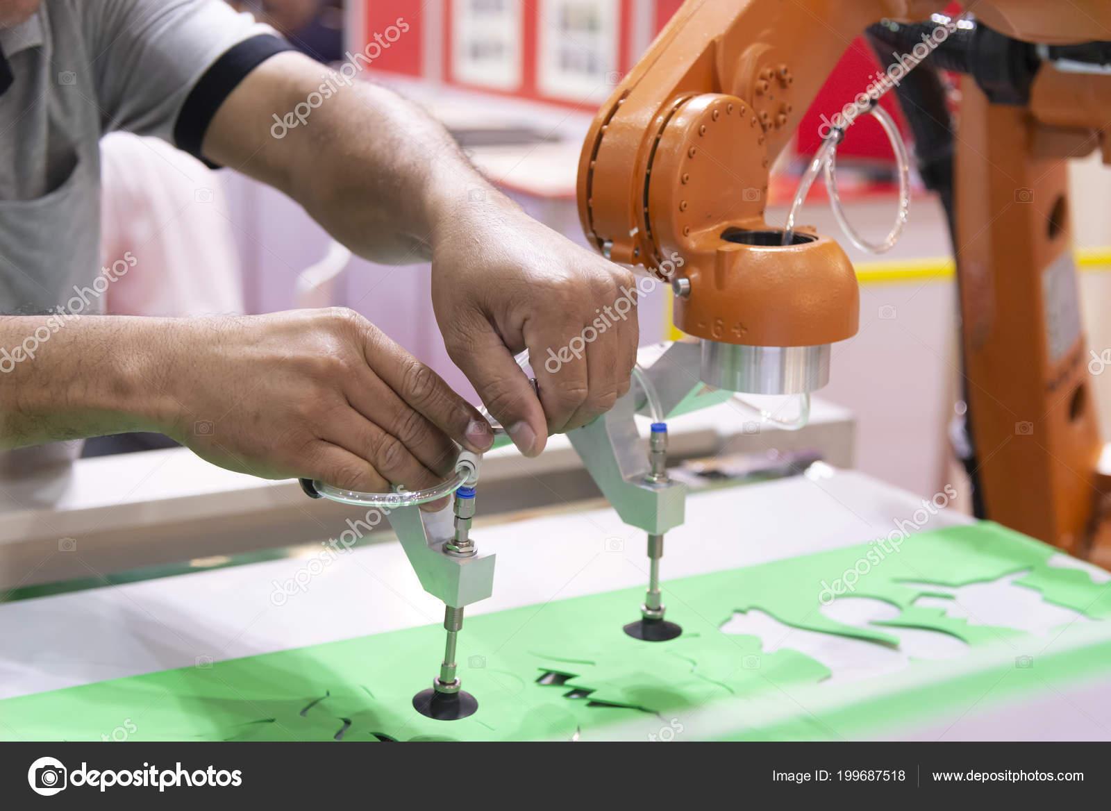 Engineer Setup Robot Arm Packaging Factory Technology