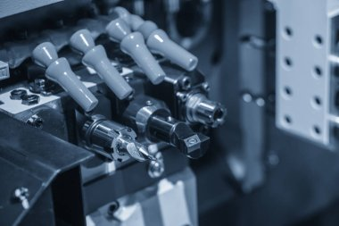 The CNC lathe or turning machine making the tread  at the brass shaft.Hi-technology manufacturing process.