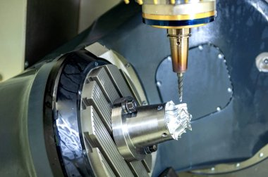 The 5-axis CNC milling machine cutting aluminium  automotive part.The Hi-Technology manufacturing process.