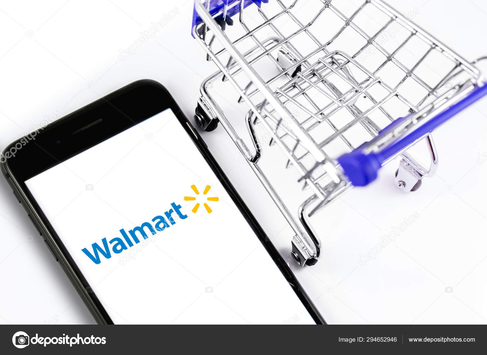 Walmart Stock Phone Number >> Shopping Cart And Walmart Logo On The Screen Smartphone