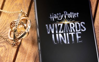 Time-Turner and smartphone with logo of Harry Potter