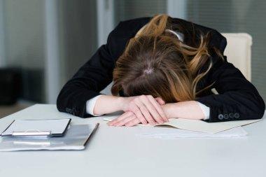 stress deadline overworking exhausted woman desk