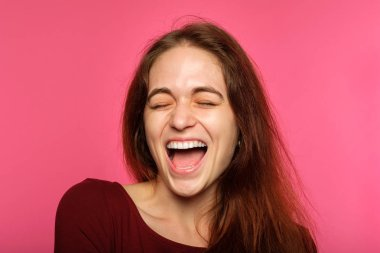 Emotion face. happy thrilled joyful delighted woman young beautiful brown haired girl portrait on pink background. stock vector