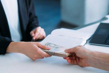 woman receiving money business bribery illegal