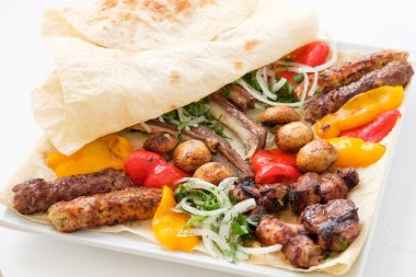 fried food platter meat vegetables flatbread