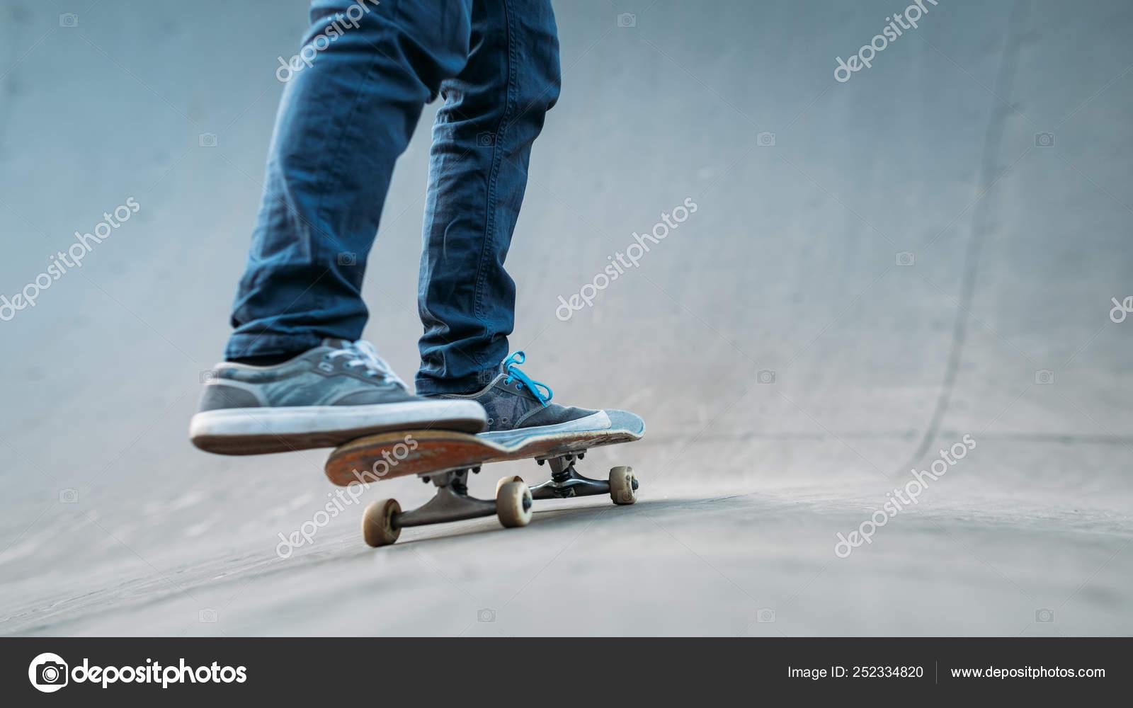 00c21e79 Urban skater man skateboard legs jeans ramp — Stock Photo © golubovy ...