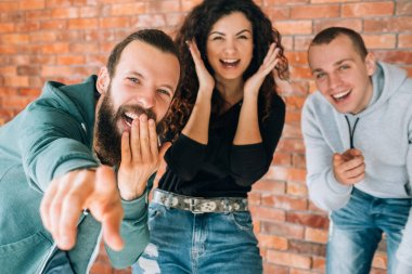 millennials amused cheerful laughing emotional