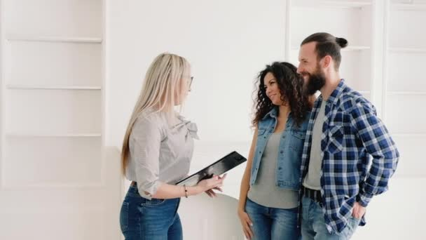 young couple buying new apartment happy owners