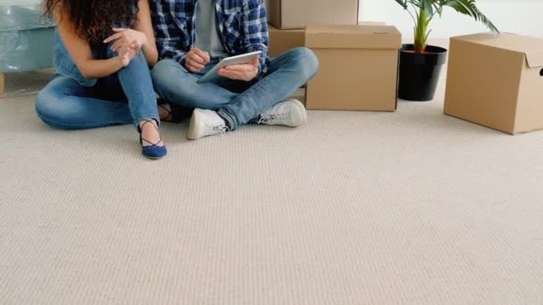 young couple new apartment buying furniture