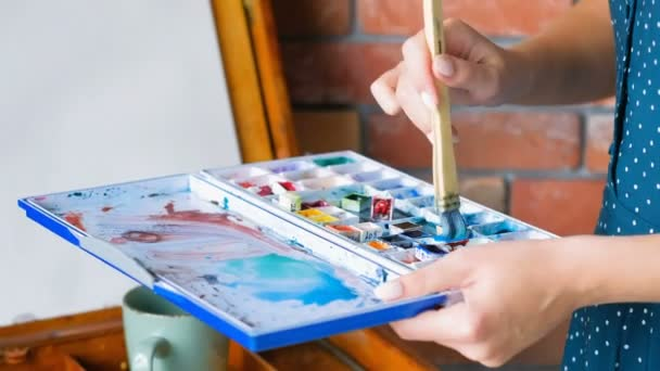 mixing watercolor create new shade blue palette