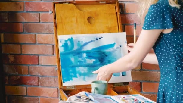 abstract painting process artist blue watercolors