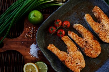 Very simple and tasty dishes on a grill pan fried salmon drizzled with lemon or lime to make it more vivid taste. To decorate your dishes, you can use onions and tomatoes