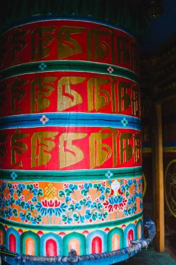 Religious prayer wheels in Nepal. Large buddhist prayer wheels made from wood at temple, Nepal.